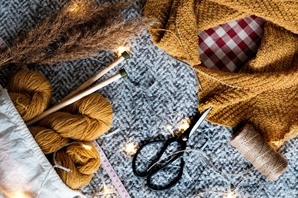 sewing materials on gray knit textile