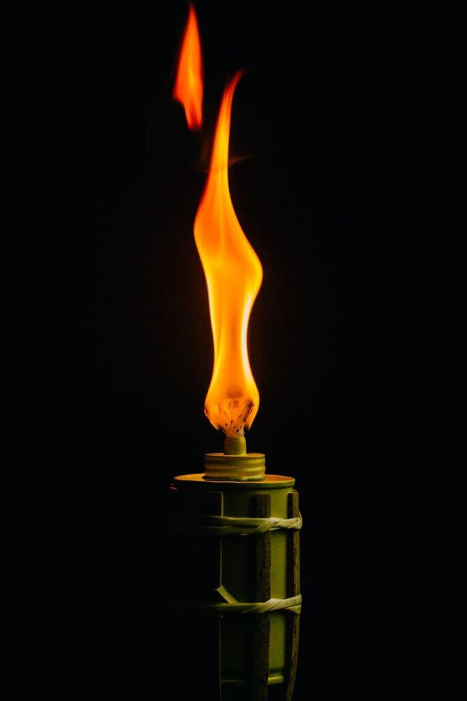 green lit torch